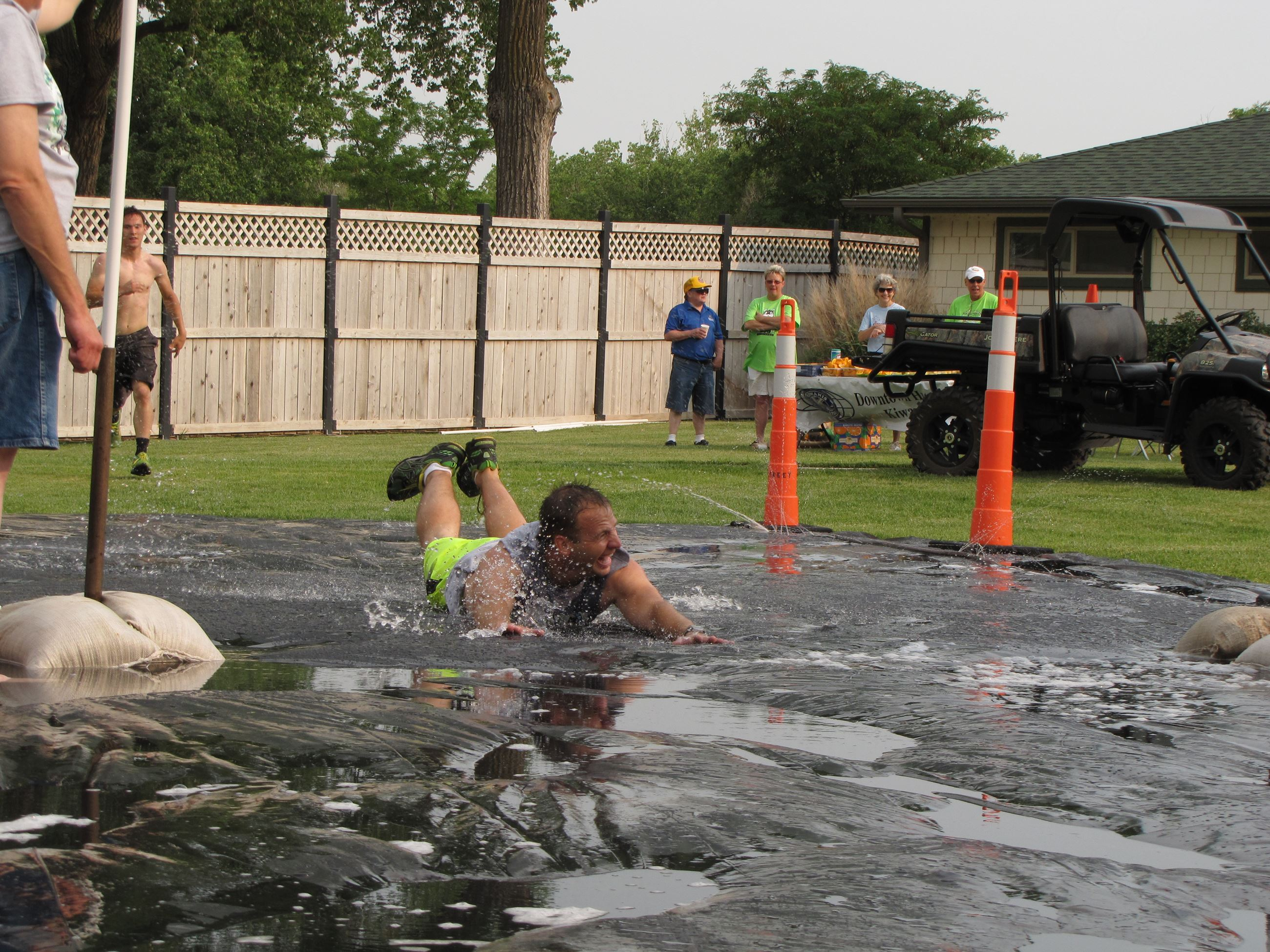 Man Sliding on Slip n' Slide